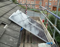 Installing solar panels on a roof requires scaffolding