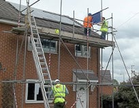 Using scaffolding fitting solar pv panels